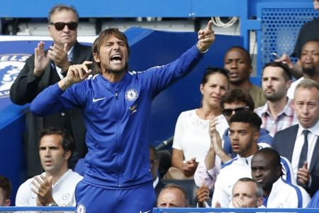Chelsea's Italian head coach Antonio Conte gestures on the touchline during the English Premier League football match between Chelsea and Burnley at Stamford Bridge in London on August 12, 2017. Burnley won the game 3-2. / AFP PHOTO / Ian KINGTON / RESTRICTED TO EDITORIAL USE. No use with unauthorized audio, video, data, fixture lists, club/league logos or 'live' services. Online in-match use limited to 75 images, no video emulation. No use in betting, games or single club/league/player publications.  /
