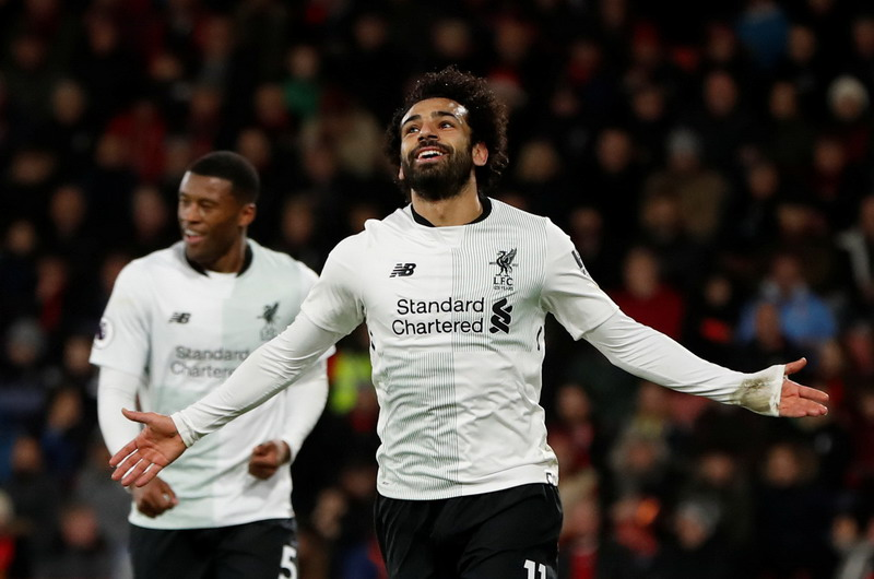 """Soccer Football - Premier League - AFC Bournemouth vs Liverpool - Vitality Stadium, Bournemouth, Britain - December 17, 2017   Liverpool's Mohamed Salah celebrates scoring their third goal    Action Images via Reuters/Paul Childs    EDITORIAL USE ONLY. No use with unauthorized audio, video, data, fixture lists, club/league logos or """"live"""" services. Online in-match use limited to 75 images, no video emulation. No use in betting, games or single club/league/player publications.  Please contact your account representative for further details."""