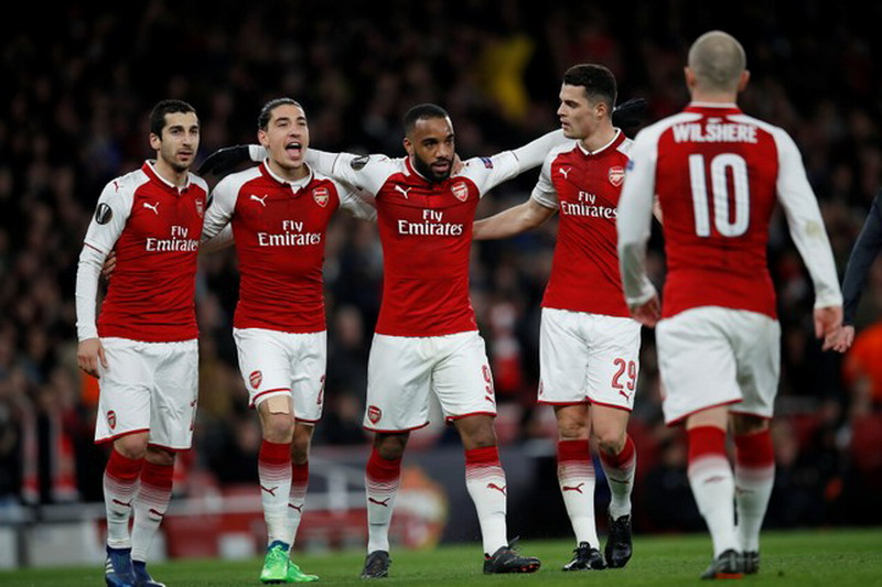 Soccer Football - Europa League Quarter Final First Leg - Arsenal vs CSKA Moscow - Emirates Stadium, London, Britain - April 5, 2018   Arsenal's Alexandre Lacazette celebrates with Henrikh Mkhitaryan, Hector Bellerin and Granit Xhaka after scoring their fourth goal    REUTERS/Eddie Keogh
